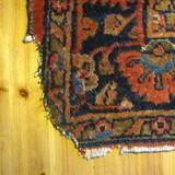 Man repairs oriental rug corner